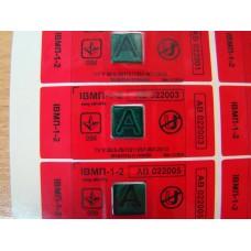 """Индикатор магнитного поля ИВМП 1-2 типа """"ИН-АТ"""" на красной пломбировочной пленке."""